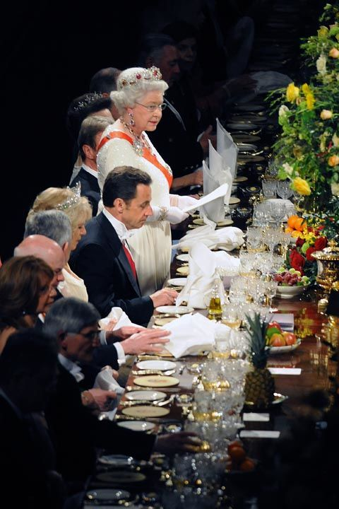 It's customary that the Queen should take the first bite at the table and when she's done eating, you should betoo.