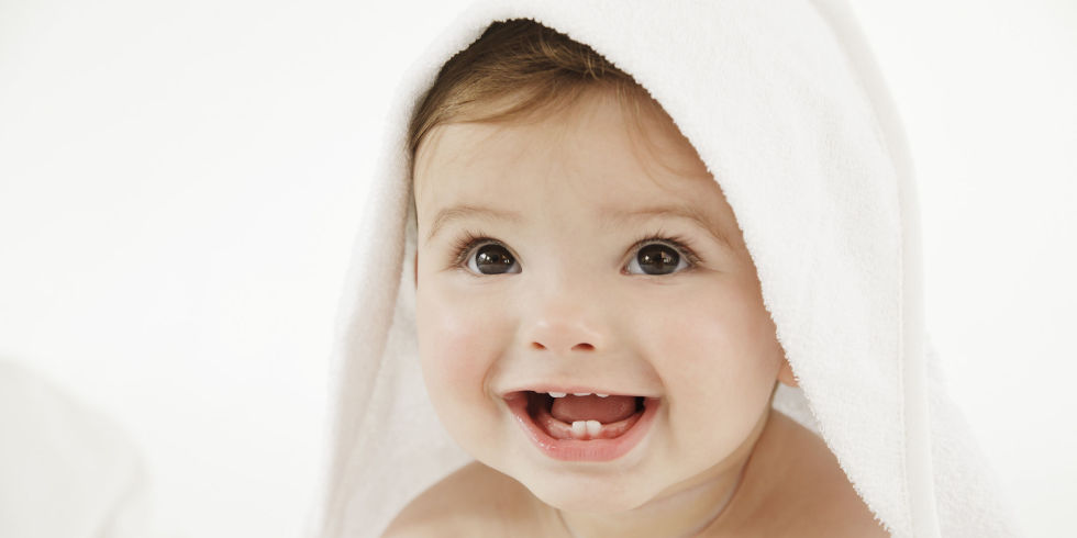 Baby Smiling Under White Towel