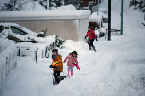children sledge snow in scotland